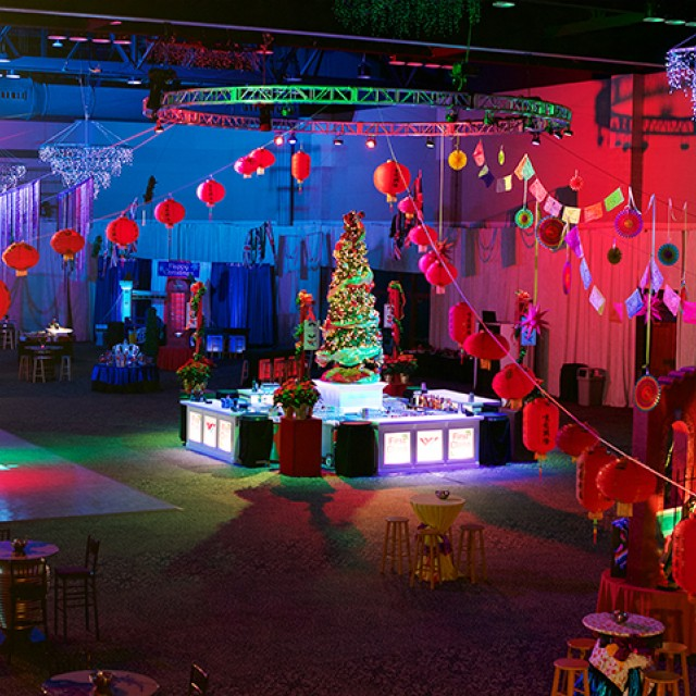 Image of North and South Exhibit Hall decorated festively for a holiday party.